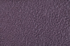 Dark violet fluffy background of soft, fleecy cloth. Texture of textile closeup Stock Images