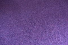 Dark violet thin simple knitted fabric. Dark violet plain thin simple knitted fabric Royalty Free Stock Photography