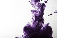 Dark violet and red ink in water abstract background Royalty Free Stock Photo