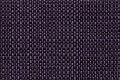 Dark violet textile background with checkered pattern, closeup. Structure of the fabric macro. Stock Images