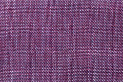 Dark violet textile background with checkered pattern, closeup. Structure of the fabric macro. Royalty Free Stock Image