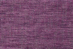 Dark violet textile background with checkered pattern, closeup. Structure of the fabric macro. Royalty Free Stock Photos