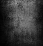 Dark wall. Closeup of textured grey wall, dark edges Royalty Free Stock Image