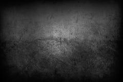 Dark wall. Closeup of textured grey wall, dark edges Royalty Free Stock Photography