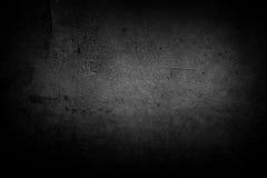 Dark wall. Closeup of textured grey wall, dark edges Royalty Free Stock Images