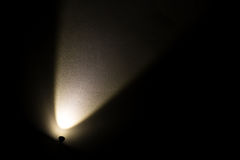 Dark Wall Illuminated from the Left Corner Spotlight Lamp Stock Photo