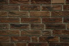 Dark wall from old burnt bricks. Dark wall from horizontal rows of old burnt bricks Royalty Free Stock Images