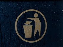 Waste Bin. A dark waste bin with gold lettering on the outside Stock Images