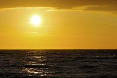 Dark waters of the Baltic Sea during sunset Stock Photos
