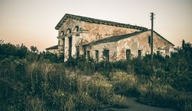 Abandoned building on the outskirts of the city Stock Photo