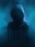 The dark web. A hooded hacker Royalty Free Stock Photos