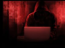 The dark web hooded hacker. Security hack concept with a hooded hacker and binary code royalty free stock image