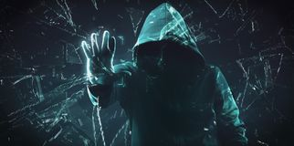 The dark web hooded hacker. Security hack concept with a hooded hacker and binary code royalty free stock photography