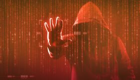 The dark web hooded hacker. Security hack concept with a hooded hacker and binary code stock images