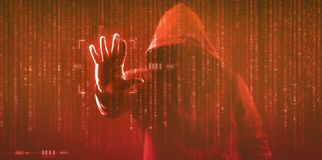 The dark web hooded hacker. Security hack concept with a hooded hacker and binary code royalty free stock photo