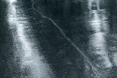 Dark wet asphalt pavement with reflections abstract background Stock Photo