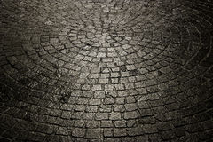 Dark wet cobblestone background Royalty Free Stock Photo