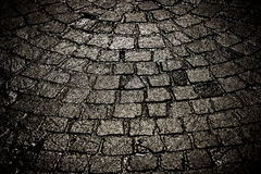 Dark wet cobblestone background tight Stock Photography