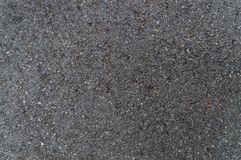 Dark wet rough asphalt texture background Stock Photography