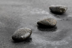 Dark and wet stones for background. Closeup of dark and wet stones for a background Stock Photography