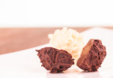 Dark and white chocoate truffles extreme close up Stock Images