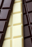 Dark and white chocolate. Close-up Royalty Free Stock Photos