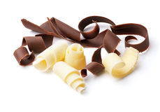 Dark and white chocolate curls. Group of dark and white chocolate shavings isolated on white stock photos