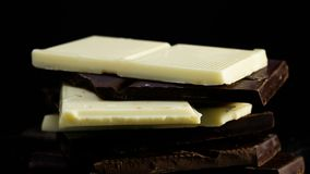 Dark and white chocolate rotating stock video footage