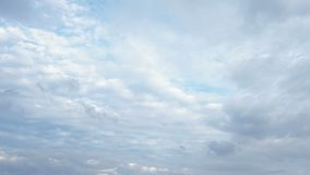 Dark and white clouds on blue sky