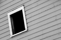 A Dark Window In A Gray Wall Royalty Free Stock Images