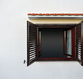 Dark window on white wall Royalty Free Stock Images