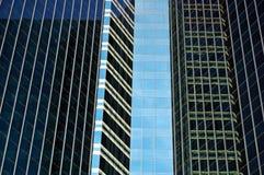 Dark windows. Glass panelling on a Bangkok towerblock Royalty Free Stock Photos