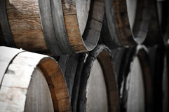 Dark Wine Barrels to store vintage wine Stock Photos