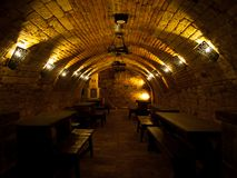 Dark wine cellar with tables Royalty Free Stock Photo