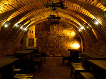 Dark wine cellar with tables Royalty Free Stock Photography