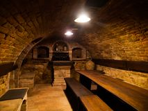 Dark wine cellar with tables Royalty Free Stock Images