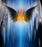 Dark winged being of fire Stock Photos