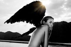 Dark wings. Girl with dark angel's wings Royalty Free Stock Images