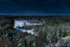 Dark winter forest. Winter panorama. Dark, frozen trees, bushes and roads Royalty Free Stock Image