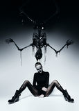 Dark woman with skull face and black skeleton. In studio Royalty Free Stock Photos