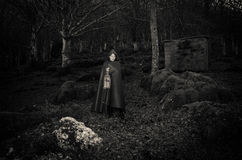 Dark woman walking in the gothic forest Stock Image
