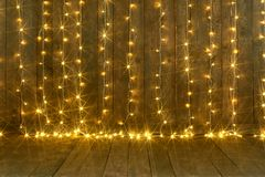 Dark wood background with lights, wall and floor, abstract holiday backdrop, copy space for text royalty free stock photography