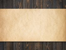 Dark wood background with old paper royalty free stock images