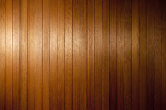 Dark Wood Texture Background. A dark wood panel background made of cedar with a soft highlight on the left side Royalty Free Stock Photography