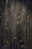 Dark Wood Background. Panel of Vertical Wooden Aged Boards with Spot of Light Stock Photography