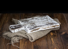 Dark wood background for product montage. Old wooden cutting board. Stock Photography