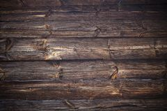Dark wood background texture. Weathered wooden logs with natural pattern grunge background royalty free stock images