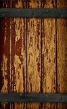 Dark Wood Barn Door. Dark Rich Wood grain barn door with peeling paint texture Royalty Free Stock Image