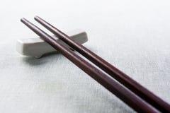 Dark wood chopsticks Royalty Free Stock Photos