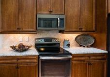 Dark Wood Granite Counter and Black Stove Stock Photos